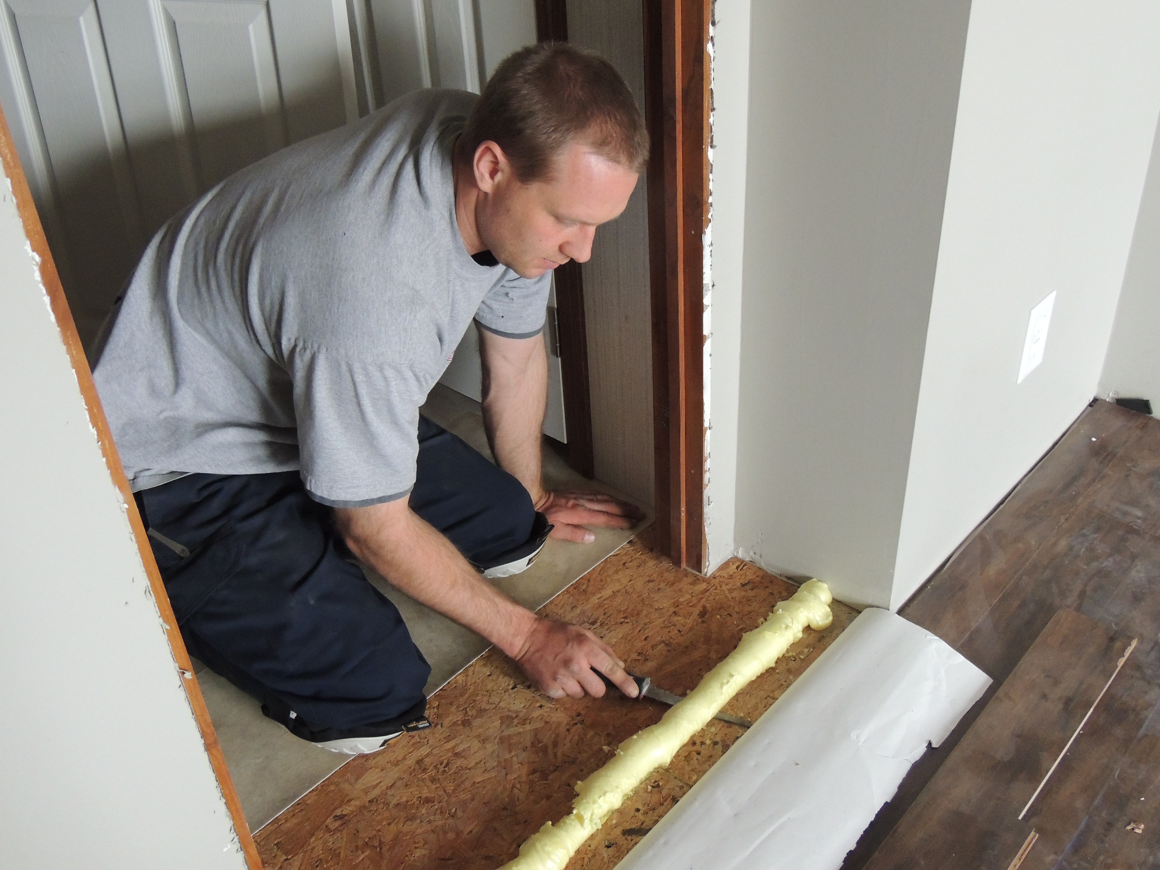 How To Install Laminate Flooring Roses And Wrenches - How to install moisture barrier under laminate flooring